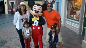 Sandy at Disney Land with her family